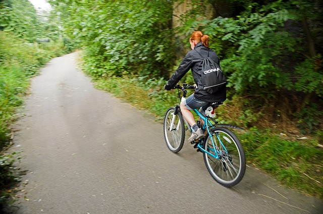 woman on bike on trail