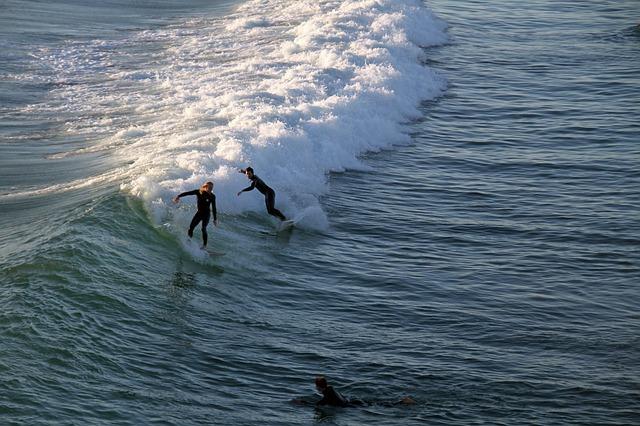 people surfing at Ocean Beach