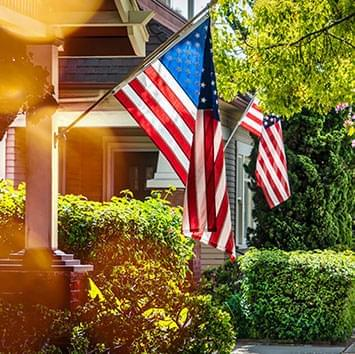 Front porches with American flags flying