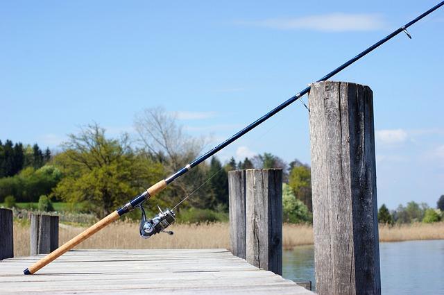 fishing rod resting on fishing dock
