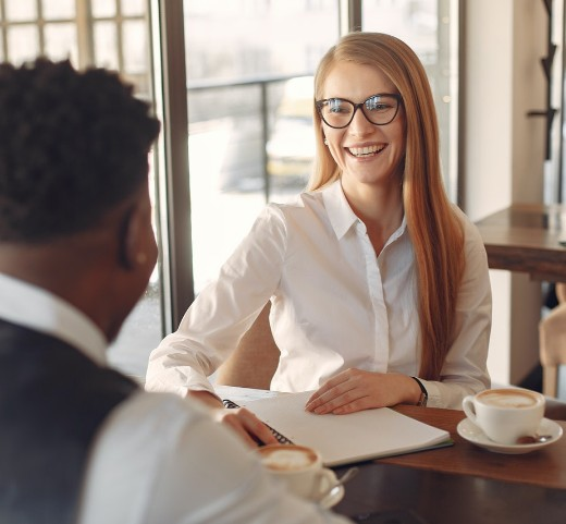 female professional having conversation with client