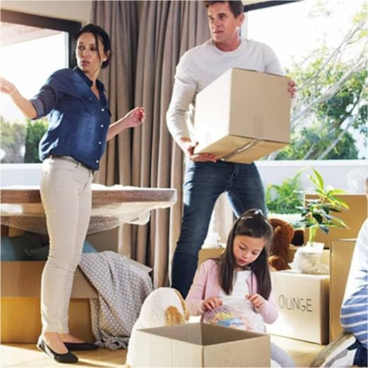 family organizing moving boxes