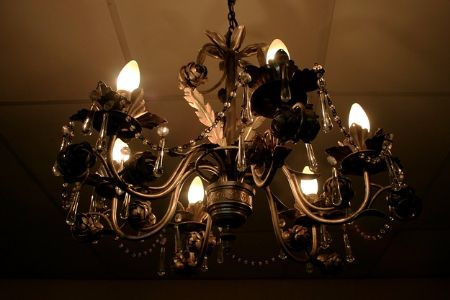 A brass chandelier hanging from the ceiling.
