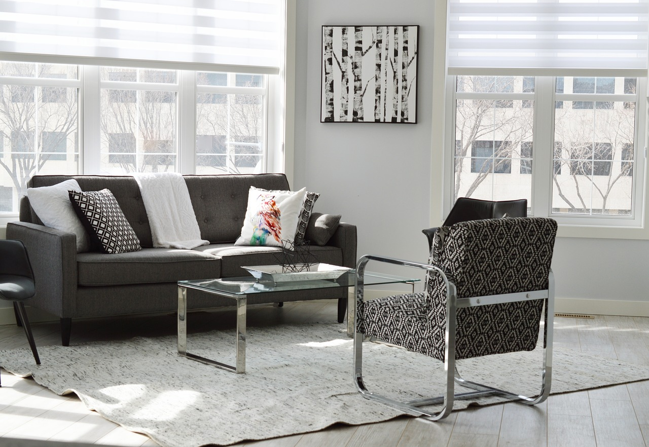 Condominium interior with a stylish couch and curtains.