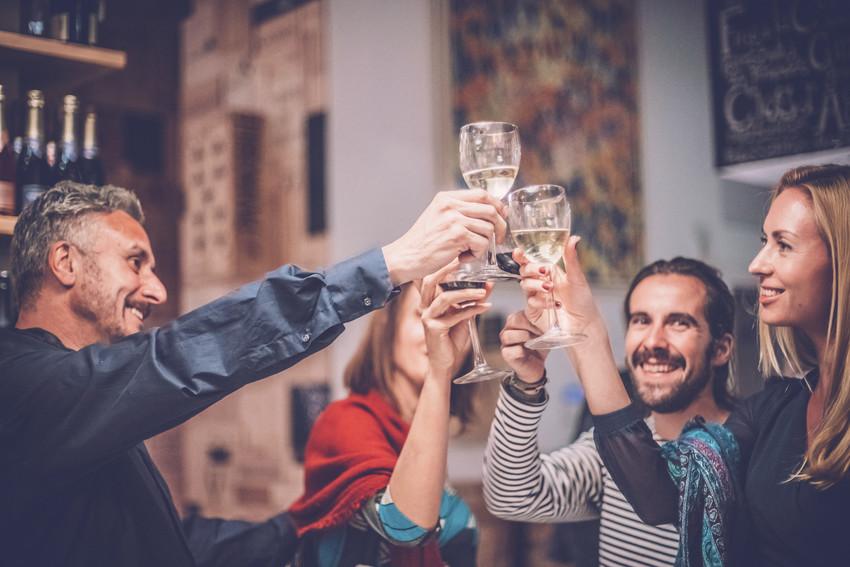 friends celebrating at a bar