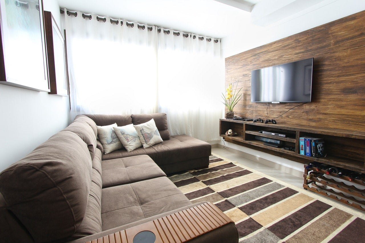 Living room with large brown couch.