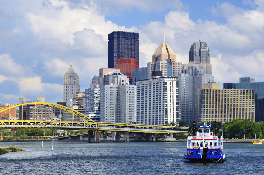 Shot of the Pittsburgh skyline by water.
