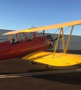 Bright yellow prop plane