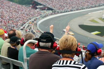 residents sitting at a NASCAR racetrack