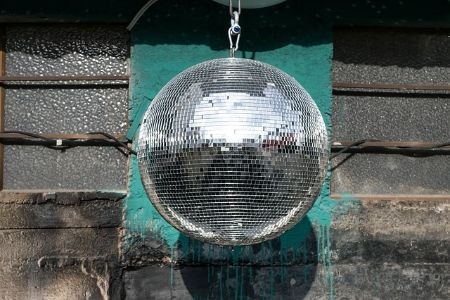 disco ball hanging over dance floor at a nightclub