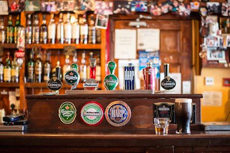 a bar with brews on tap