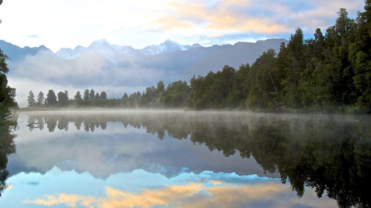 sunrise reflected in beautiful mountain lake