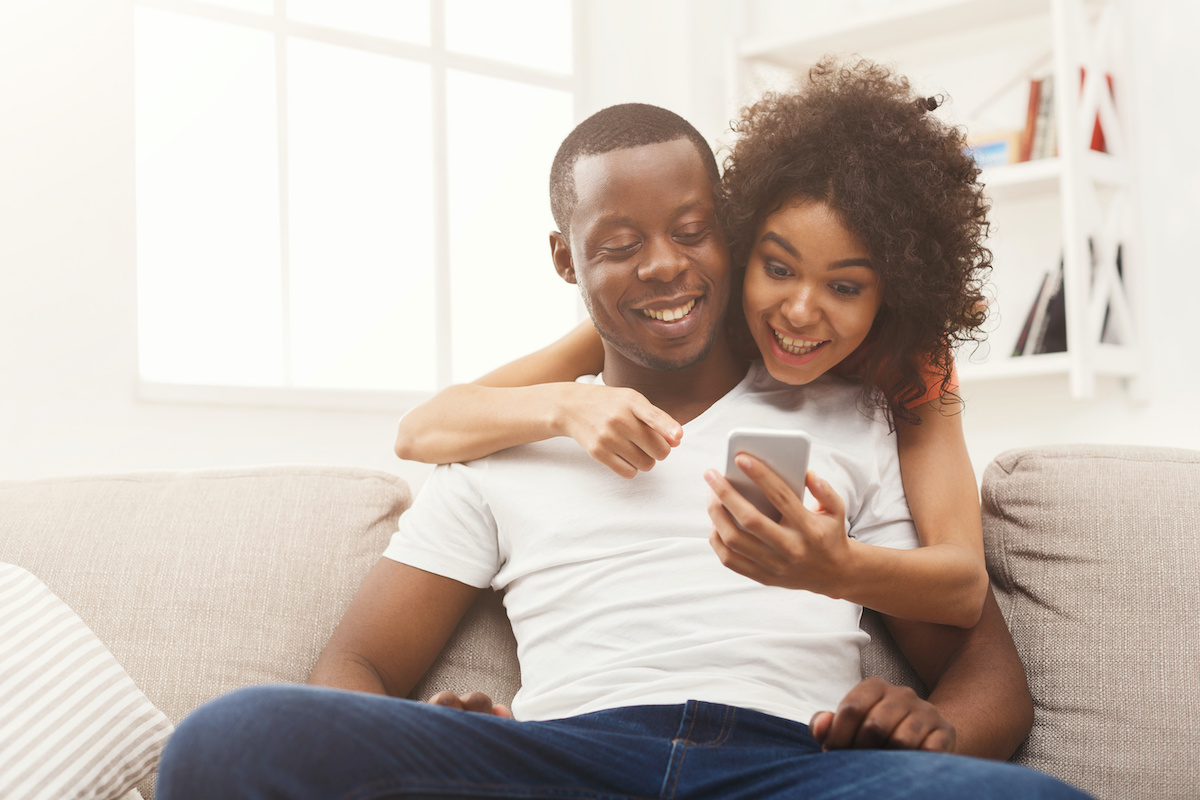 Couple watching TikTok on a mobile phone