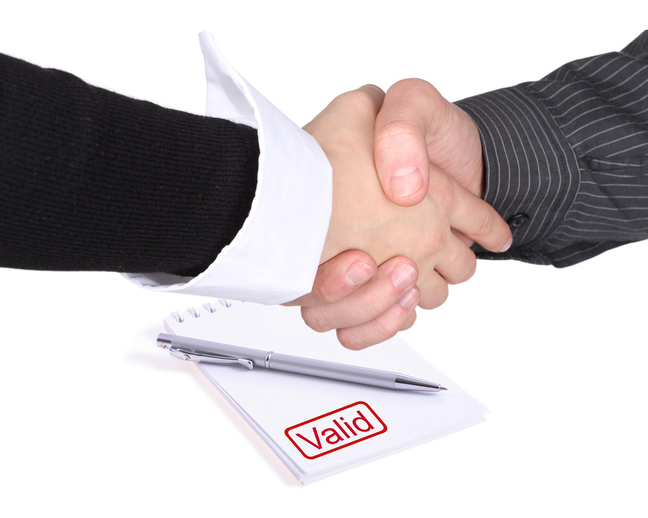 business people shaking hands above valid contract