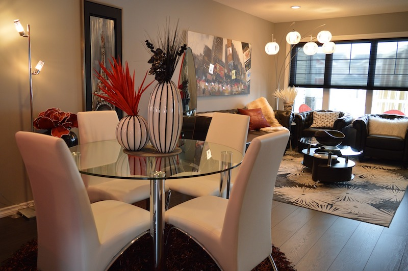 a cleanly staged modern dining and living room