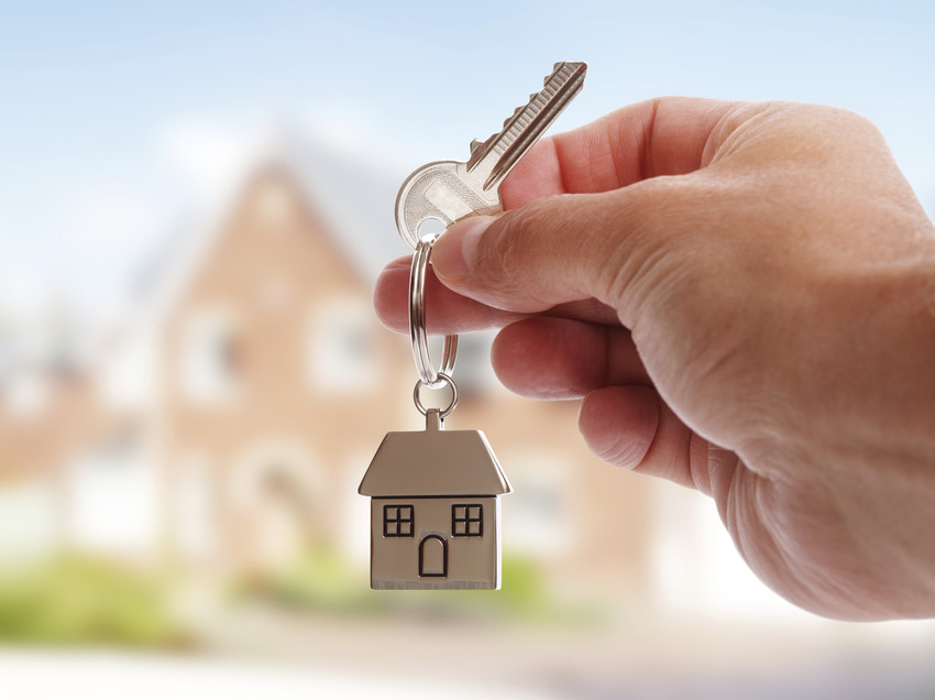 real estate agent holding keys to home