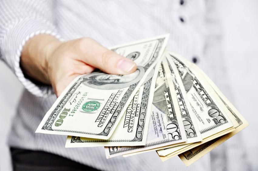 seller holding cash