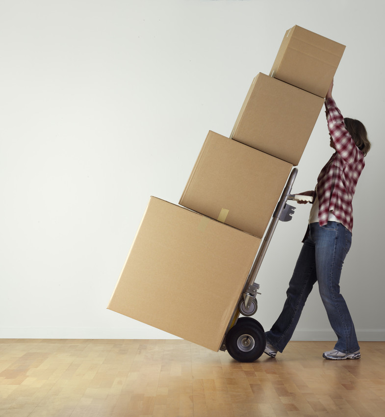 a person transporting a stack of moving boxes