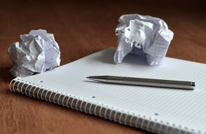 notebook and crumpled pieces of paper