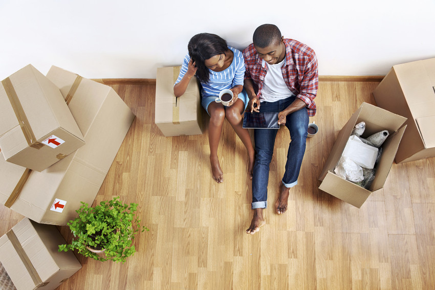 first-time home buyers with moving boxes