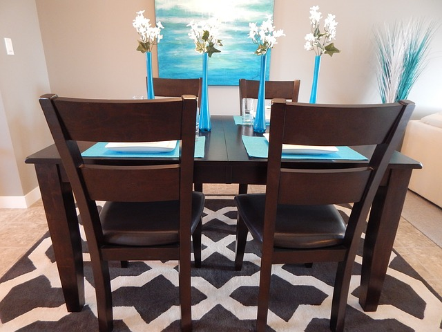 a dining room table with blue place settings