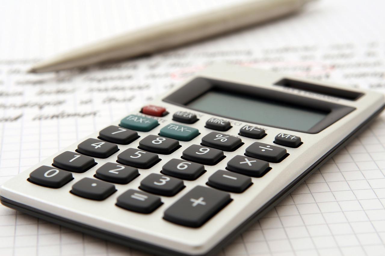 A calculator on top of a finance sheet.