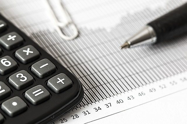 Calculator next to a finance graph.