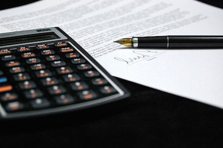A calculator next to a mortgage application.