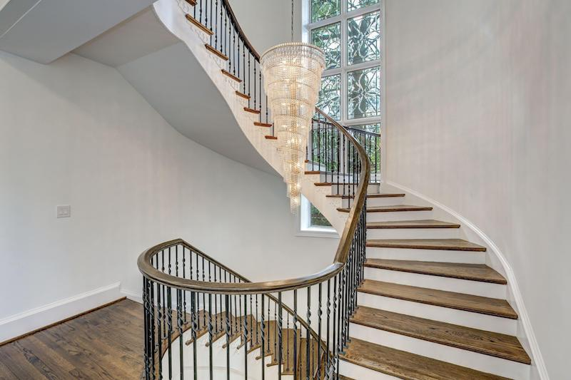 winding stairway illuminated by a crystal chandelier