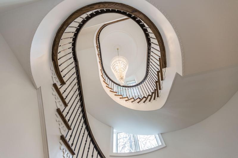 looking up at spiral stair case
