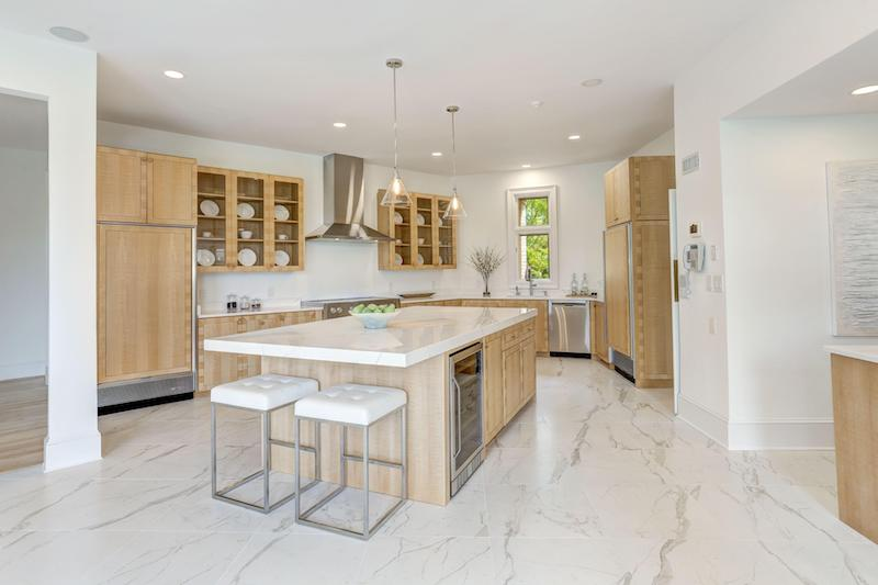 white marble kitchen with light wood