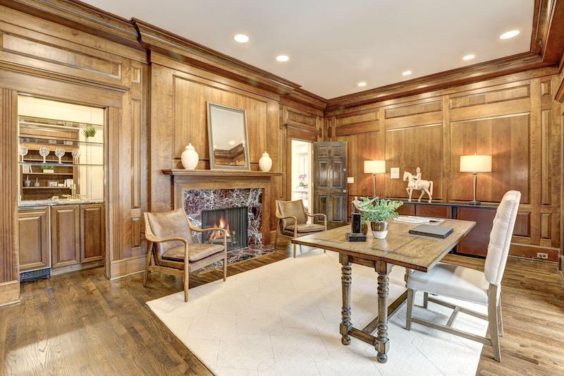 wooden office room with fireplace
