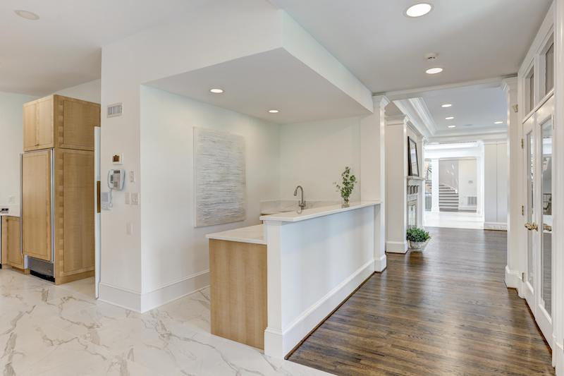 corner view of white marble kitchen and hallway
