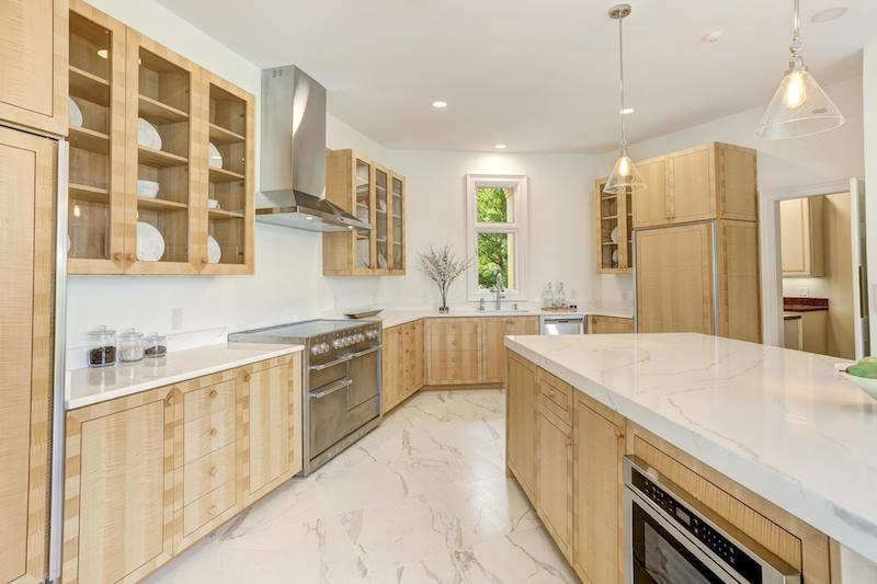 close up of white marble kitchen with light wood