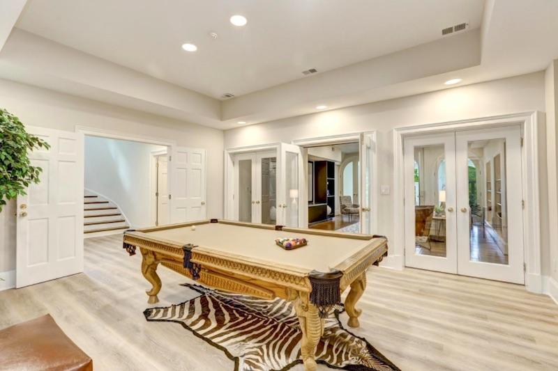 white pool room with brown zebra print