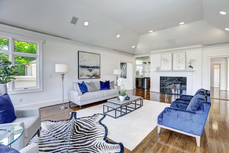 blue and white living room with black fireplace