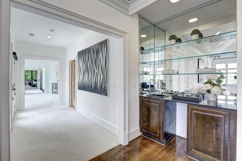 white hallway with zebra striped picture and glass shelves