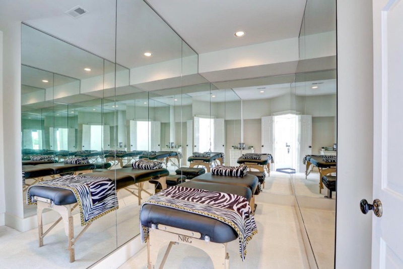 massage room with mirrors and zebra stripes