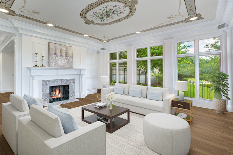 living room with pink couches and view of a fireplace