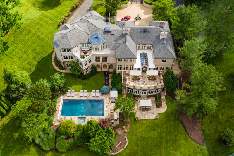 top view of tan stone house with pool