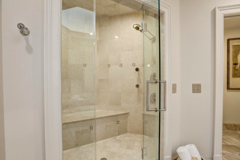 white walk in shower with chair