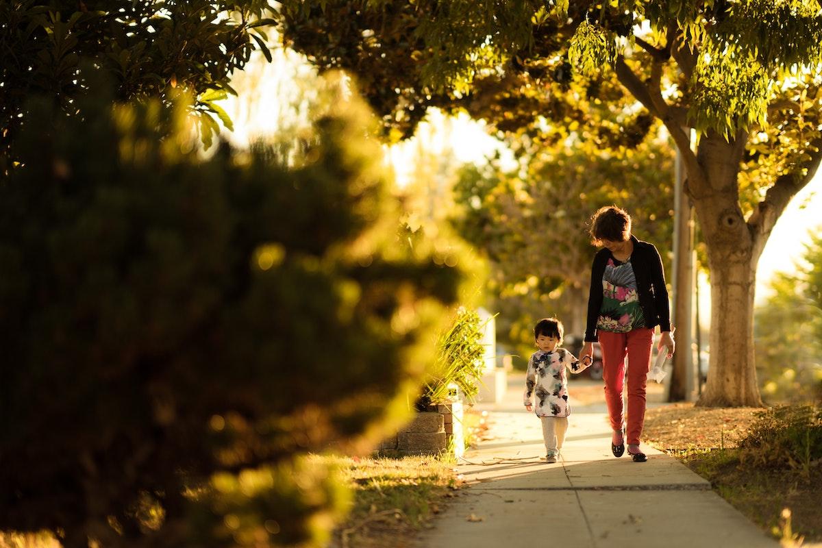 strolling on sidewalk