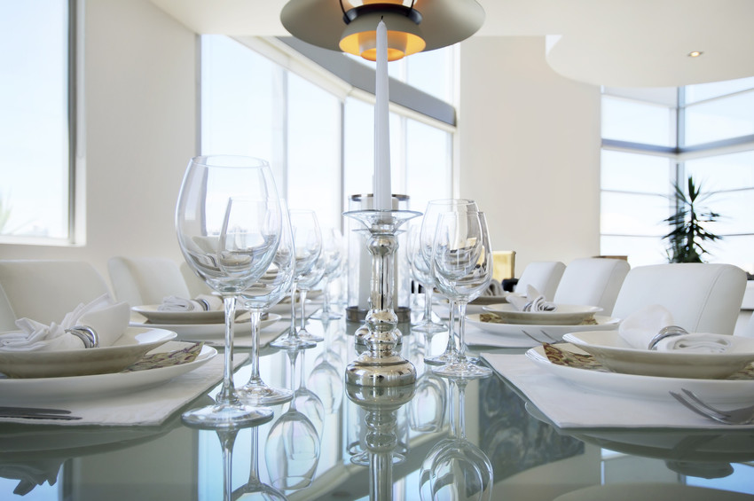 a dining room with nice place settings