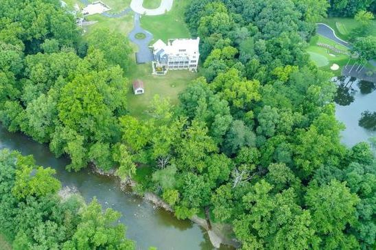aerial shot of river rock farms home for sale