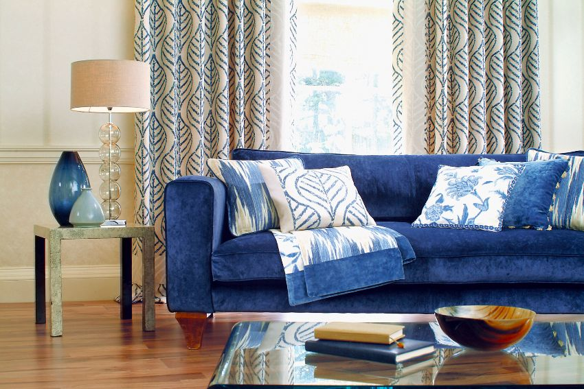 charming living room with blue couch