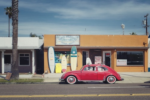 VW Beetle in front of surf shop