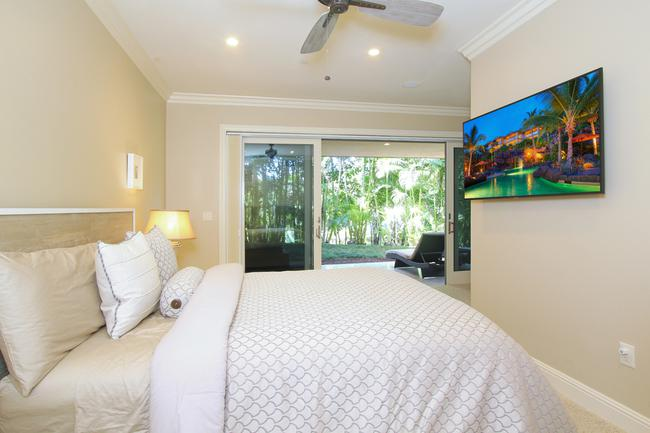 The Downstairs Master Suite Has Been Thoughtfully Divided Up Into Two Bedrooms, This Photos Shows The 3rd Bedroom, Each With Lanai Access!