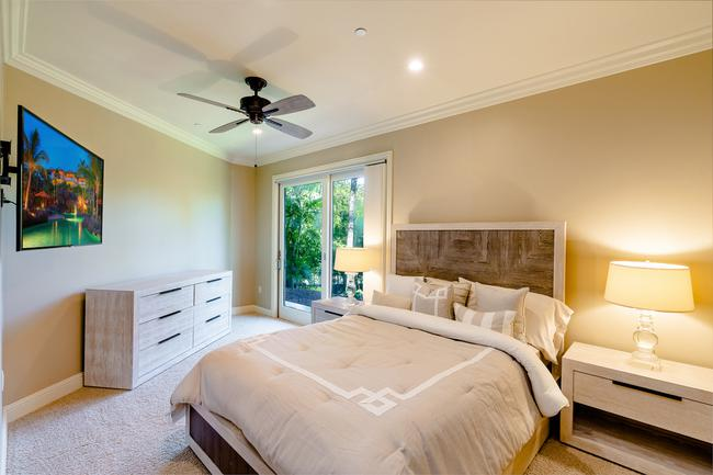 The Downstairs Master Suite Has Been Thoughtfully Divided Up Into Two Bedrooms, This Photos Shows The 4th Bedroom, Each With Lanai Access!