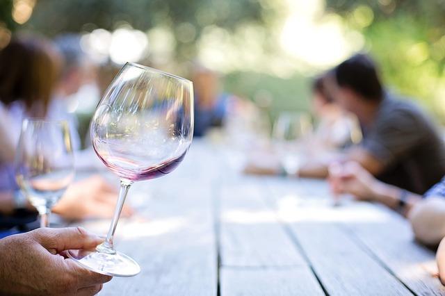 sampling wine at a vineyard