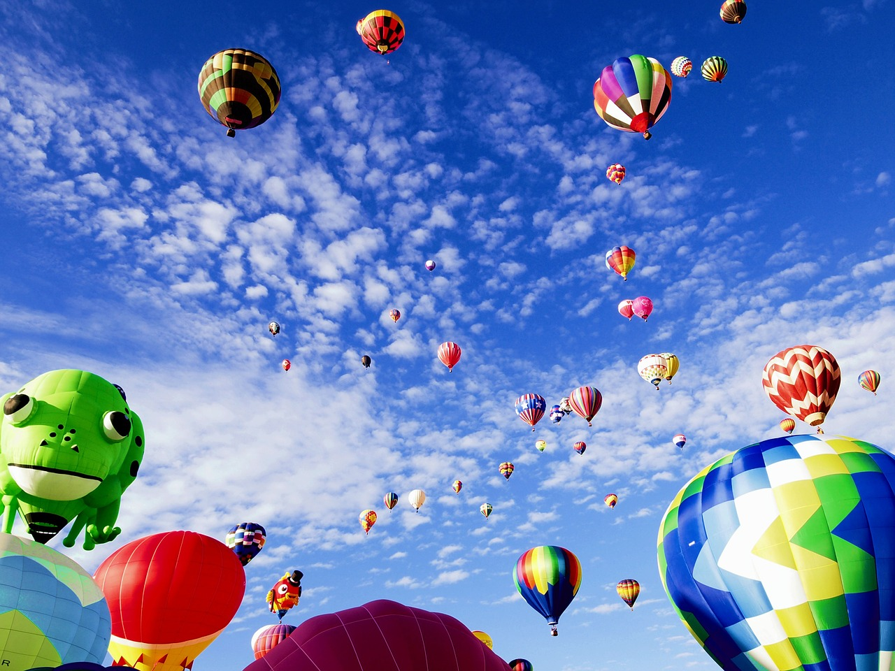 Hundreds of hot air balloons in the sky.